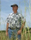 """Frank Norman, of Norman Ecological Consulting, looks over one of the few parcels of remaining tallgrass prairie in the area, west of Lawrence. """"The state of our prairies is dwindling and with that goes history,"""" he says."""