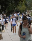 KU students walk on campus Wednesday. Stricter policies led to the dismissal of 884 students last year.