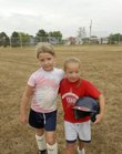 Amanda Snodgrass, left, 8, walks off the baseball field hugging her sister Kiera Snodgrass, 9, at the Wakarusa Valley School on Wednesday, Sept. 5, 2007.  Kiera, who has down-syndrome, has been part of Lawrence Park and Recreation Department's Special Populations Program.  Declining enrollment has the Snodgrass family worried about the future of the program.
