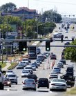 Traffic pushes through the 1300 block of 23rd Street on Thursday in this file photo. Lawrence-Douglas County Planning Commissioners are asking for public comment on Transportation 2030, a federally mandated plan that spells out the area's top transportation needs.