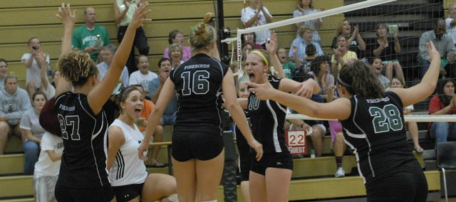 Free State volleyball players - From left, Taylor Manning, Alyx Glover, Ali Jacobsen, Brooke Carter and Ali McDermott - celebrate a point against Leavenworth. The Firebirds swept the Pioneers on Monday at FSHS, moving their record to 9-2.