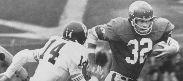 Former Kansas University running back John Riggins (32) runs against Oklahoma. Riggins will be inducted to the KU Ring of Fame on Oct. 13, at KU's game against Baylor.