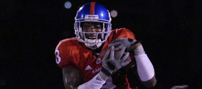 Kansas University cornerback Aqib Talib pulls in an interception with a smile. He returned the ball 100 yards for a touchdown against Florida International, and 6News sports director Kevin Romary deemed it the play of the game in the Jayhawks' 55-3 rout of the Golden Panthers on Sept. 22, 2007.