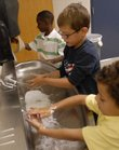 Second-graders at Prairie Park school wash their hands before lunch Monday, Sept. 24, 2007. From left are Jayden Douglas, Blair Whaley and Matthew Pitts.