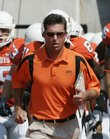 Oklahoma State coach Mike Gundy leads his team onto the field against Texas Tech in Stillwater, Okla. OSU beat the Red Raiders Saturday, but Gundy spent his postgame news conference delivering a rant against newspaper columnist Jenni Carlson.