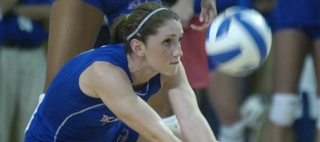 KU Freshman Melissa Manda digs a ball during Wednesday night's home volleyball match against the University of Nebraska at Horejsi Center.