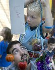 Jason Ptaszek, bottom, supports five-year-old Luke Gottschamer on his shoulders Sunday, Sept. 23, 2007 while decorating for the Jewish holiday Sukkot at the Lawrence Jewish Community Center, 917 Highland Dr.