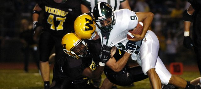 Free State's Craig Rosenstengle (9) barrels over the Shawnee Mission West defense at the end of a touchdown run. Free State pummeled SM West, 32-0, Thursday in Overland Park.