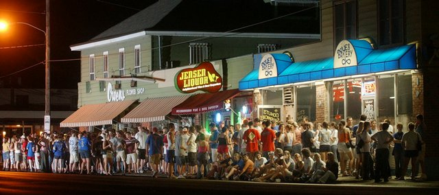 Students from Kansas University's scholarship halls wait for doughnuts outside Joe's Bakery, 616 W. Ninth in this file photo from 2003.  Joe's Bakery, a staple for KU students seeking late night and early morning eats, is currently closed amid dwindling sales and an uncertain lease situation.