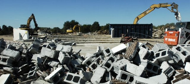 Cinder blocks from the former South Junior High School are piled along the outskirts of the site as the removal process of the old building continues.