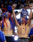 Kansas University basketball fans, from left, Cody Spencer, Altamont, 15; Hunter Cline, Altamont, 14; and Jacob Wertz, Altamont 14, celebrate the beginning of basketball season at Late Night in the Phog on Friday at Allen Fieldhouse.
