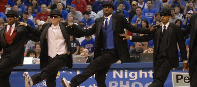 """Kansas University senior basketball players, from left, Rodrick Stewart, Brad Witherspoon, Darnell Jackson and Jeremy Case dance as Russell Robinson sings """"New York, New York."""" The Jayhawks performed the skit Friday at the 2007 Late Night in the Phog in Allen Fieldhouse."""