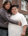 Connor McCreaddie, 8, who weighs 218 pounds, and his mother, Nicola McKeown, of Wallsend, England, shown in this file photo, could be separated if Connor is taken into protective custody. On Monday, health officials said obesity among children has become an epidemic and should be addressed where they spend much of their time - in school.