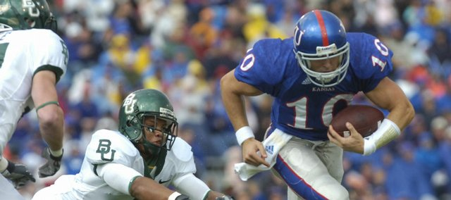KU's Kerry Meier out-runs Baylor's Dwain Crawford on Saturday, Oct. 13, 2007 during the Jayhawks football game at Memorial Stadium.