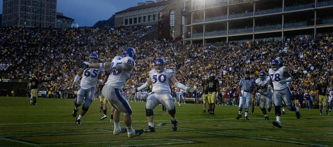 Kansas University offensive lineman Ryan Cantrell (50) runs in to celebrate with tight end Derek Fine (85) following Fine's fourth-quarter touchdown reception. The TD proved decisive in the Jayhawks' 19-14 victory over Colorado on Saturday in Boulder, Colo.