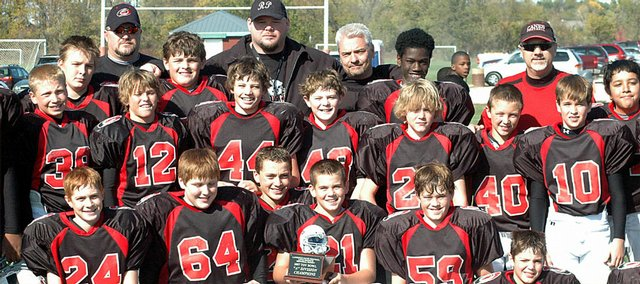 The sixth-grade Lawrence Hurricanes enjoy their Toy Bowl trophy after defeating the Cougars on Saturday at Youth Sports Inc.