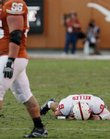 Nebraska quarterback Sam Keller, right, lays on the ground after being injured during the fourth quarter of the Huskers' loss to Texas. Keller suffered a shoulder injury and won't play Saturday at Kansas University.