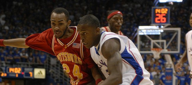 Kansas guard Rodrick Stewart drives against Pittsburg State guard Carlos Taylor in the Jayhawks' 94-59 victory. Stewart had 11 points in KU's exhibition victory Thursday at Allen Fieldhouse.