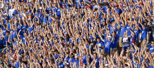Kansas fans wave the wheat following a field goal by Scott Webb in the first half of the Jayhawks' 19-14 victory over Colorado. KU improved to 7-0 with the victory Saturday in Boulder, Colo.
