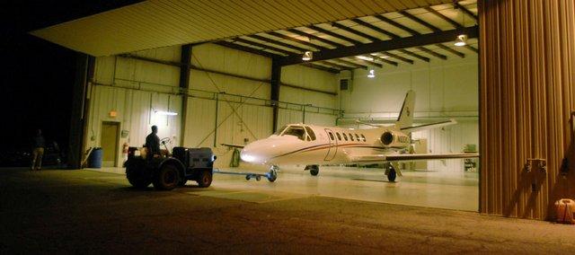 A Kansas University aircraft rests in its hangar at Lawrence Municipal Airport.