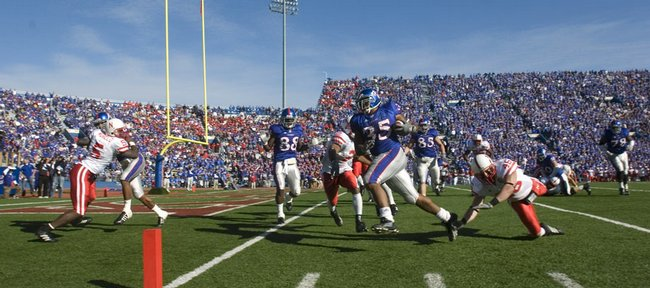 Kansas running back Brandon McAnderson races into the end zone for the Jayhawks' final touchdown against Nebraska. McAnderson tied a school record with four rushing TDs, and KU set a handful of other records in a 76-39 rout of the once-mighty Huskers on Saturday at Memorial Stadium.