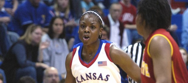 Danielle McCray dribbles downcourt during the Jayhawks' 82-48 exhibition victory over Pittsburg State. McCray led the Jayhawks with 20 points Sunday in Allen Fieldhouse.
