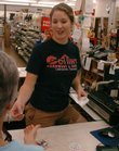 Kate Naramore, who works at Cottin's Hardware, 1832 Mass., makes change for a customer on Wednesday, August 15, 2007. An increase in sales tax is one way the city can raise more money to fund its growing needs.