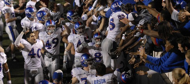 The Jayhawks flock to their fans following their 43-28 victory over Oklahoma State.  Kansas improved to 10-0 with the win Saturday in Stillwater, Okla.