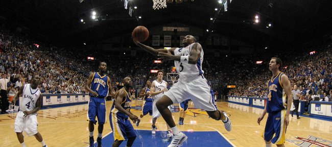 Kansas University's Russell Robinson puts in a reverse layup against UMKC. Robinson had 15 points and nine assists in the Jayhawks' 85-62 victory Sunday in Allen Fieldhouse.