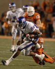 Kansas receiver Marcus Henry (86) is brought down by Oklahoma State defensive back Jacob Lacey. Henry finished with 199 yards on eight catches.