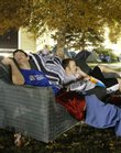 Kansas University students, from left, Jeremy Todd, a freshman from Liberal, and Paul Wetzel, an Olathe freshman, pass the night resting on a couch on the lawn of Allen Fieldhouse waiting to pick up tickets to the KU-Missouri football game on Nov. 24 at Arrowhead Stadium in Kansas City, Mo. Some students weren't happy that after waiting for tickets all night, some more comfortably than others, the only available seats to the game were in the upper deck of Arrowhead.