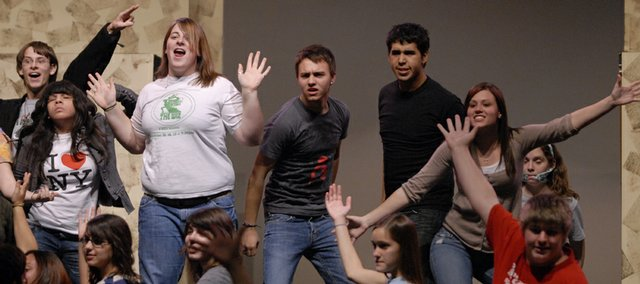 "The cast of the Free State High School musical ""Urinetown"" performs a number during rehearsal last Wednesday. The show opens Thursday at the school, 4700 Overland Drive."