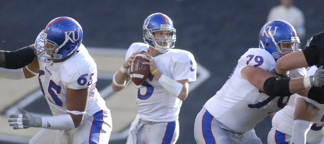 Kansas quarterback Todd Reesing bides his time behind the protection of the offensive line as he looks to pass during the first half against the Buffaloes, Saturday, Oct. 20, 2007 at Folsom Field in Boulder.