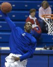 Kansas forward Darrell Arthur throws down a windmill dunk as he and his teammates warm  up before tipoff Thursday, Nov. 15, 2007 at Allen Fieldhouse.