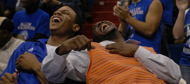 Kansas University guards Brandon Rush, left, and Sherron Collins bust out laughing while watching fellow guard Rodrick Stewart stumble after a tomahawk dunk in the second half of KU's 92-60 rout of Washburn. Rush made his season debut Thursday at Allen Fieldhouse, while Collins sat out his first game after undergoing foot surgery.