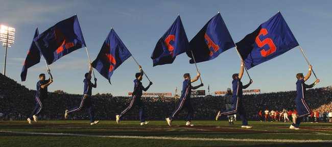 Jayhawk cheerleaders march around Memorial Stadium flying their Kansas flags Saturday, Nov. 17, 2007 during KU's 45-7 home victory against Iowa State.