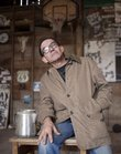 Rural Lawrence character Wayne Propst hangs out in the barn that sits on his property north of Lawrence. Propst is the subject of a photo documentary series by Lawrence native Nick Vaccaro.