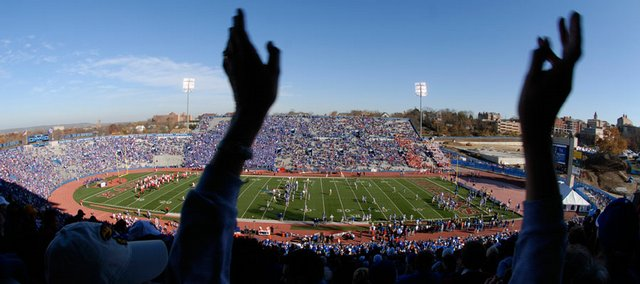 Pat Wicke, Lenexa, claps her hands as the Jayhawk lineup is announced at Memorial Stadium. KU went on to beat Iowa State, 45-7, on Saturday in the Jayhawks' home finale. Sunday, the Jayhawks ascended to No. 2 in all the major national polls and the BCS standings.