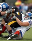 Kansas' Joe Mortenson (8) and John Larson bring down Missouri running back Tony Temple on Saturday, Nov. 25, 2006 at Columbia, Mo in this file photo.