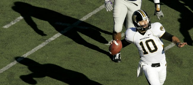 Missouri quarterback Chase Daniel (10) looks for a receiver against Kansas State. Daniel, 6-foot on a good day, and Kansas University's Todd Reesing, listed at 5-foot-10, did not receive recruiting interest from football powerhouses in their home state of Texas. Now both are Heisman Trophy contenders.