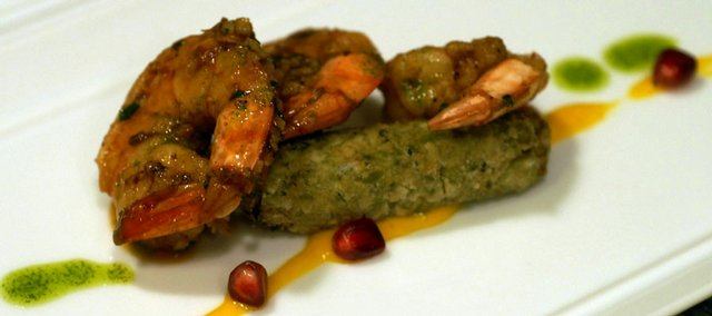 Mongolian spiced shrimp on Falafel with Roasted Saffron Oil, Mint Cilantro Oil and Pomegranate Seeds was on a recent menu at Krause Dining.