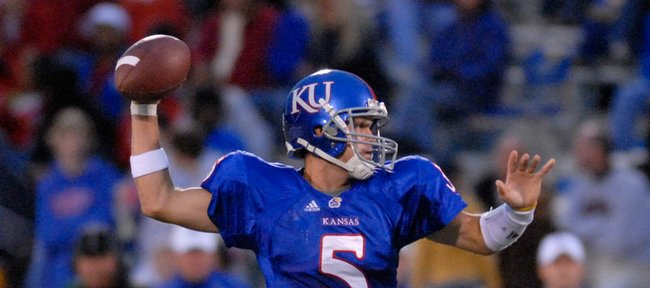 Kansas University quarterback Todd Reesing zeroes in on a receiver during the Jayhawks' 45-13 victory over Toledo in September at Memorial Stadium.