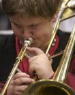 Allan Hunt plays the trombone during rehearsal of the Lawrence All-City Junior High Jazz Band.