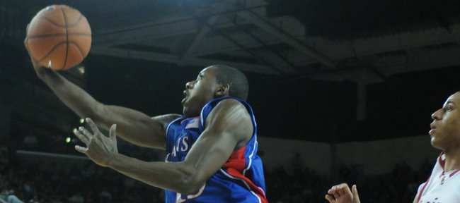 Kansas guard Mario Chalmers soars to the bucket past Souther California defender Dwight Lewis during the second half Sunday, Dec. 2, 2007 at the Galen Center in Los Angeles.
