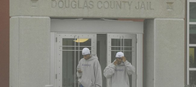 KU basketball player Brandon Rush, left, with Michael Lee, graduate student manager for the KU men's basketball team, leaves the Douglas County Jail Thursday after Rush was arrested on two outstanding warrants for failure to appear in court for traffic violations. Rush was released from jail after posting $500 bond.