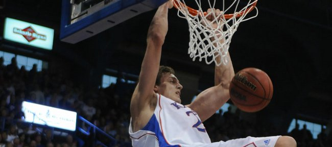 DePaul forward Karron Clark can only watch as Kansas center Sasha Kaun explodes for a dunk during the second half Saturday, Dec. 8, 2007 at Allen Fieldhouse. Kaun is the starting center for Russia at the World Championships in Turkey and is making an impact for the team.