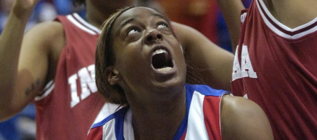 Kansas University sophomore Porscha Weddington (34) lets out a scream while making a move under the basket. The Jayhawks beat Indiana, 69-61, Sunday at Allen Fieldhouse.