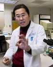 Dr. Samuel Kim talks Friday in a lab at Kansas University Hospital. Kim is a pioneer in research to preserve the fertility of cancer patients, including developing a procedure that removes a woman&#39;s ovaries during cancer treatment and reimplants the tissue in the body after the patient is cancer free.