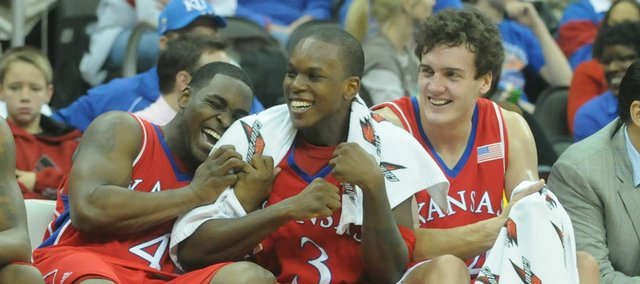 Jayhawks, from left, Sherron Collins, Russell Robinson and Sasha Kaun yuk it up on the bench in the second half of KU's 88-51 rout over Ohio. Kansas made its Sprint Center debut in a blowout victory Saturday in Kansas City, Mo.