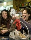 Shoppers Peggy Taylor, Lawrence, center, and Karen Riveland, Topeka, right, have a laugh with Becky Snyder, employee of The Bay Leaf, 725 Mass., as the two look for gifts over the lunch hour Thursday. Recent harsh weather has pushed back holiday shopping for many.